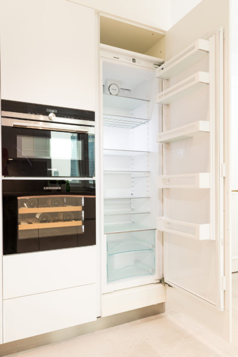 Executed Project, Dubai, Old Town, Business Bay, Schüller C collection, White kitchen with grey countertop, small wine cooler, integrated fridge, Liebherr