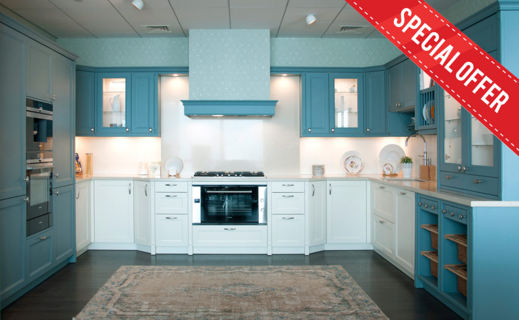 country kitchen on sale. heavily discounted price. special offer. sky blue and white wood cabinets doors with handle in this country style kitchen.