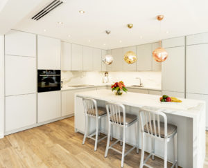 Kitchen Island in White and Grey Kitchen on Parquet floor in Dubai by Goettling interiors