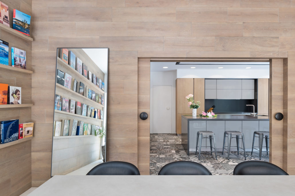 Wooden pocket doors as the separation between the kitchen and living area cum library study area in Arabian Ranches villa Dubai