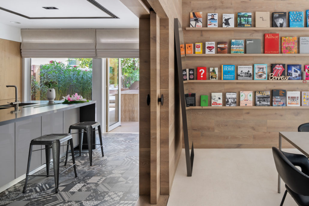 Wooden pocket doors as the separation between the kitchen and living area in Arabian Ranches villa Dubai