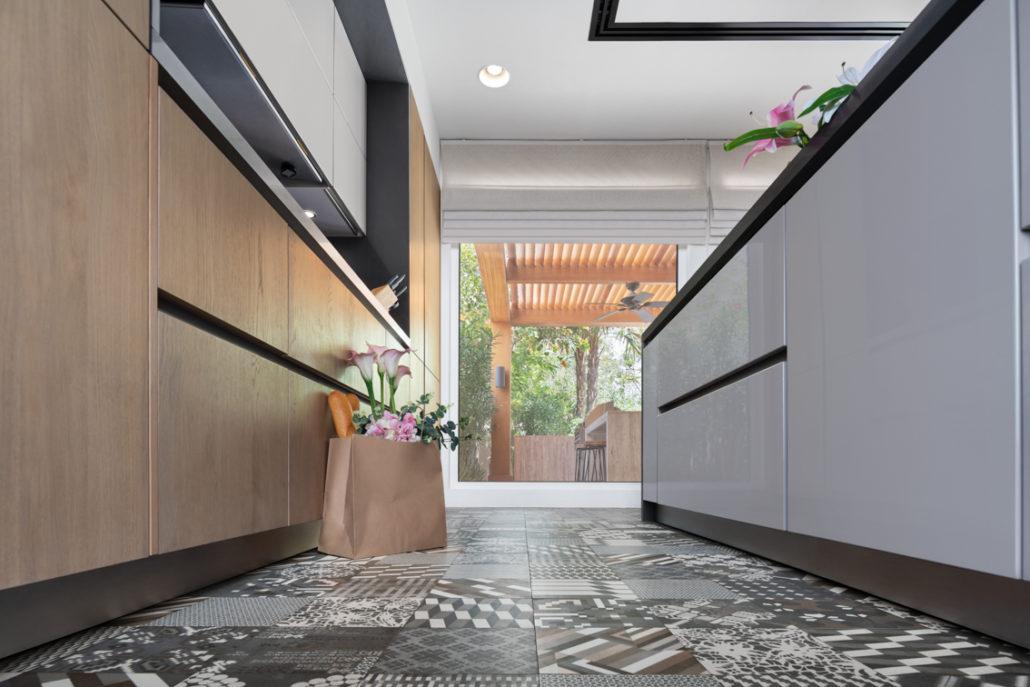 Decorative floor tiles adding pop in the Schüller kitchen in Arabian Ranches Dubai